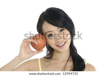 Pretty smiling woman with apple - stock photo