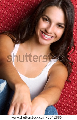 Pretty smiling young brunette woman - stock photo
