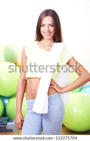 Pretty sporty girl in fitness room - stock photo