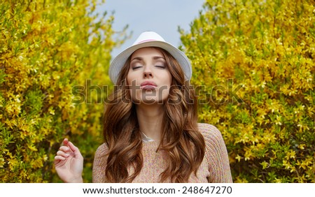 Pretty spring woman in the garden  - stock photo