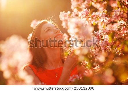 Pretty spring woman in the garden. - stock photo
