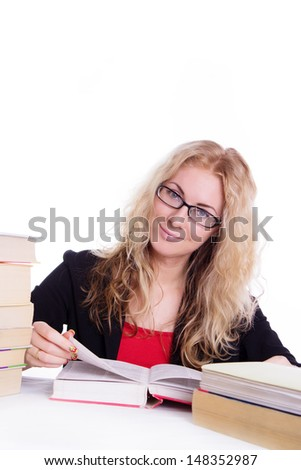 Pretty student girl with pile of books isolated on white
