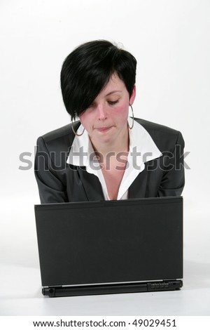 Pretty student lady in black with a lap top isolated in a white background