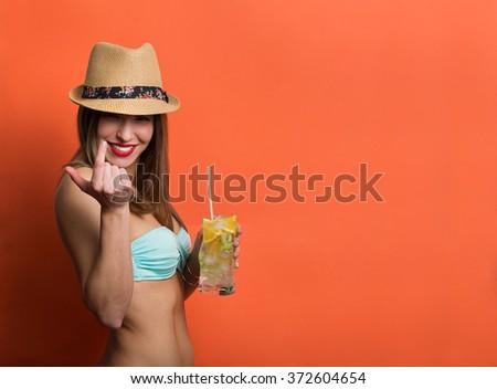 Pretty stylish girl in bikini holding cold drink - stock photo
