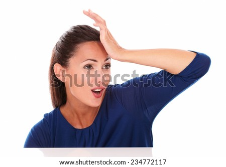 Pretty stylish girl with hand on forehead looking to her left surprised in white background - copyspace