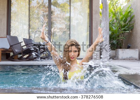 Pretty swimsuit fashion young sexy asian woman posing in luxury pool resort - stock photo