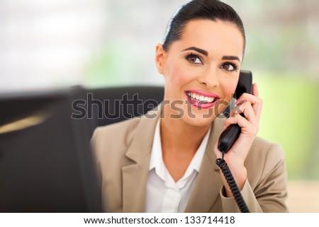 pretty switchboard operator answering telephone - stock photo