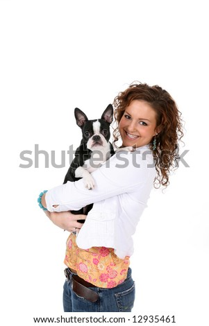 Pretty teen and her Boston Terrier; over a high key background.