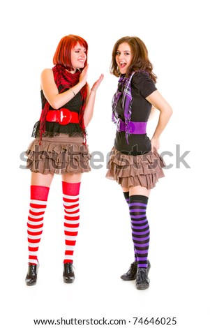 Pretty teen girl admiringly applauding her pleased girlfriend isolated on white - stock photo