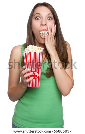 Pretty teen girl eating popcorn