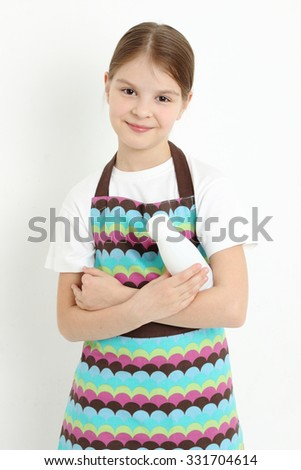 Pretty teen girl holding a milk bottle - stock photo