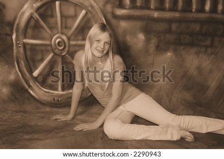 pretty teen girl in western background - stock photo
