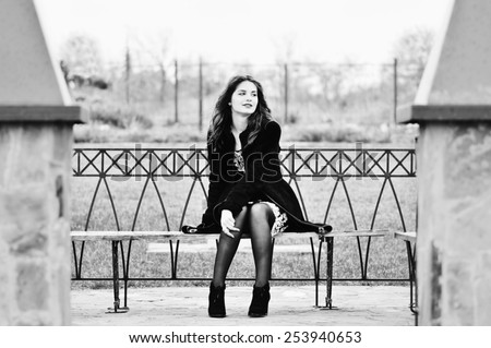 pretty teen girl sitting on the bench