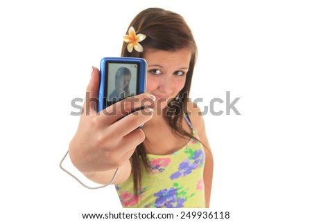 pretty teen girl taking selfies with her photo camera - stock photo