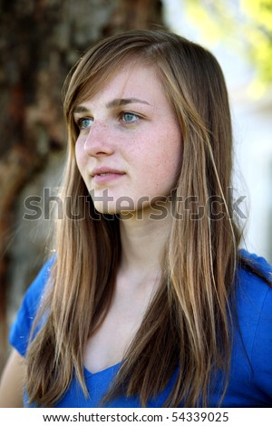 pretty teen girl with freckles outside