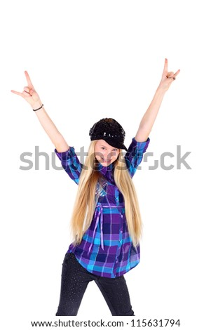 pretty teen modern girl in the checkered shirt and the sequin cap and trousers with her hands up - stock photo