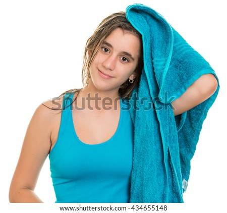 Pretty teenage girl drying her wet hair  with a towel - Isolated on a white background - stock photo