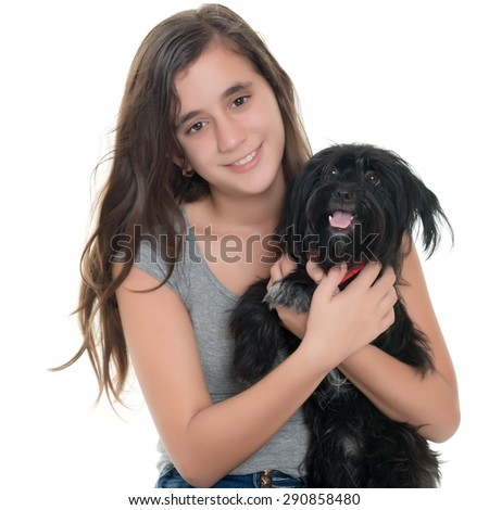 Pretty teenage girl hugging her pet dog isolated on white - stock photo
