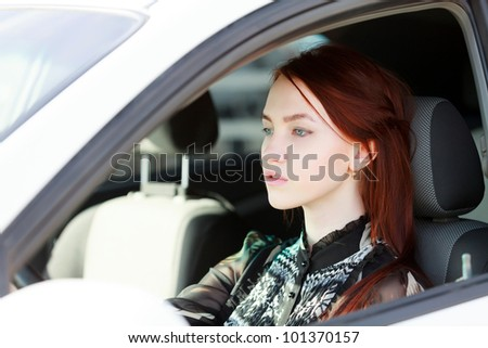 Pretty teenage girl in a car