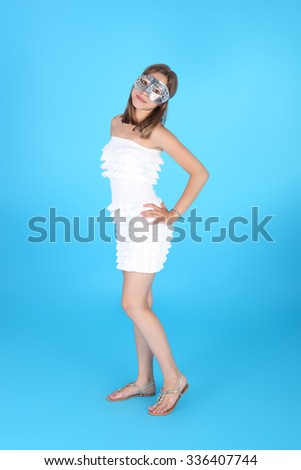 pretty teenage girl in the carnival mask