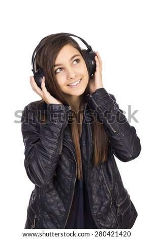 Pretty teenage girl listening music on her headphones isolated on white background - stock photo