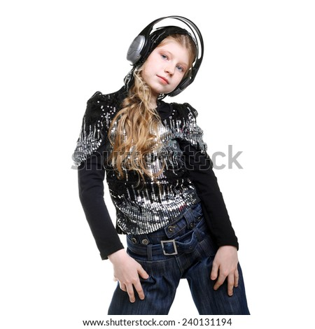 pretty teenage girl listening to the music in headphones and dancing - stock photo