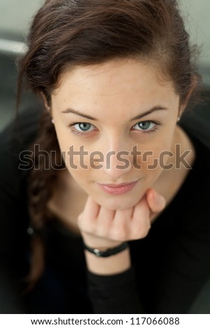 Pretty teenage girl looking at camera