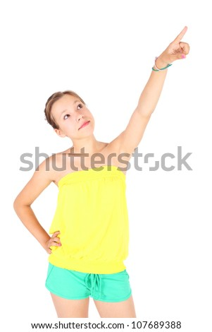 pretty teenage girl pointing up something overhead