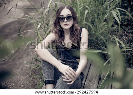 pretty teenage girl posing outdoors dressed casual - stock photo