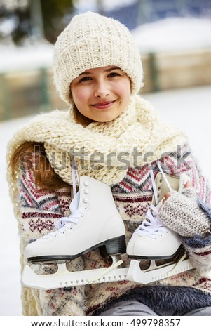 Pretty teenage girl prepares for ice skating