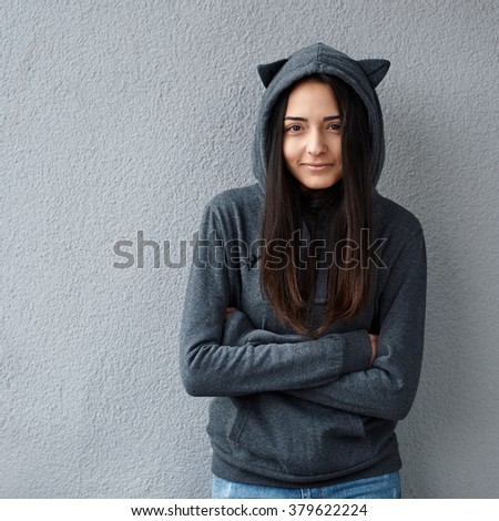 Pretty teenager girl heats from the cold - stock photo
