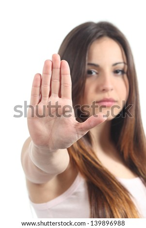 Pretty teenager girl making stop gesture with her hand isolated on a white background - stock photo