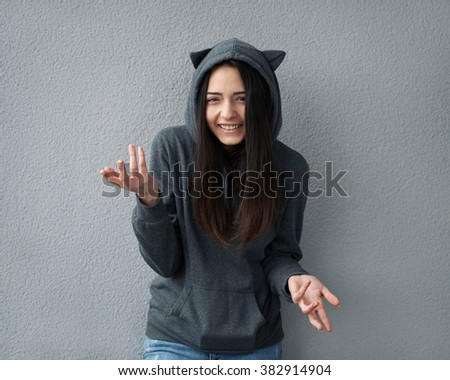 Pretty teenager girl taunts happening - stock photo