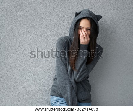 Pretty teenager girl taunts you - stock photo