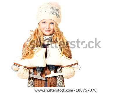 Pretty ten years girl standing with figure skates. Isolated over white. - stock photo