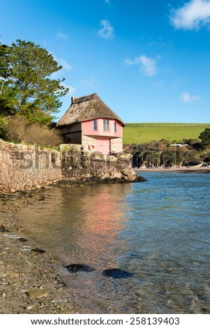 Pretty thatched boat house on the mouth of the river Avon at Bantham on the south Devon coast