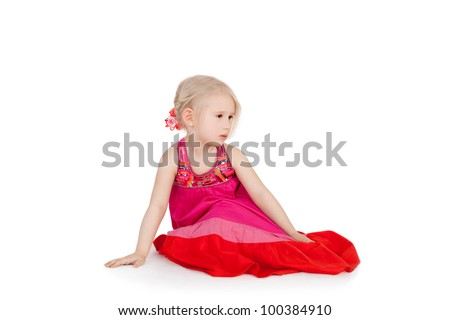 pretty thoughtful little girl sitting in the folk dress