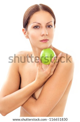 Pretty topless woman with apple on white background-healthy life - stock photo