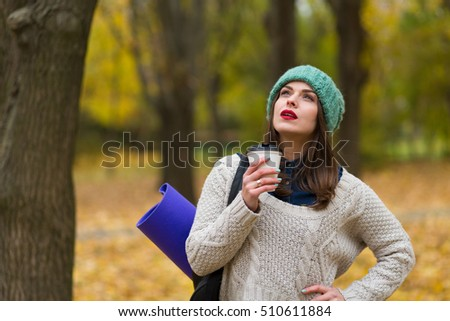 Pretty tourist woman in the autumn forest
