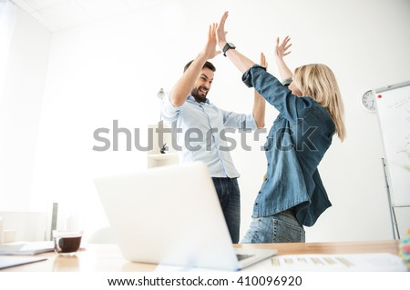 Pretty two workers are celebrating their success - stock photo