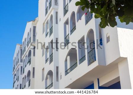 Pretty typical white houses Puerto Banus, Malaga Spain - stock photo