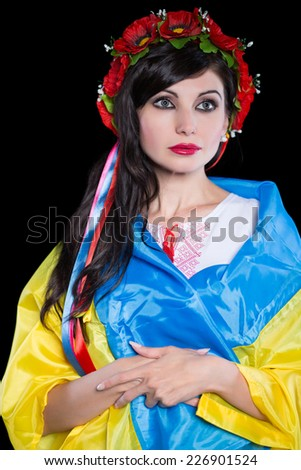 Pretty Ukrainian brunette posing in poppy wreath. Isolated on black
