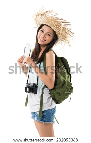 Pretty Vietnamese tourist with backpack and digital camera