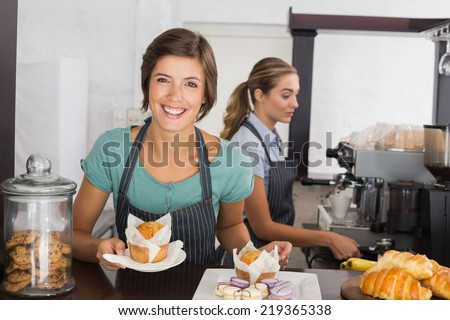 Pretty waitresses working with a smile at the coffee shop - stock photo