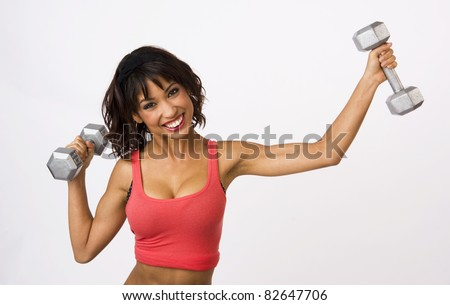 Pretty Weight Lifter Smiles During Work Out with Barbells