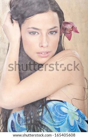 Pretty wet woman in vapor behind glass - stock photo