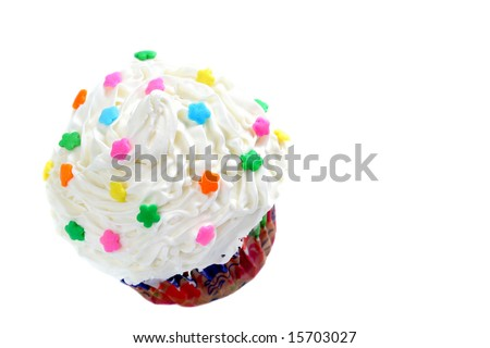 Pretty white frosted cupcake appears to be flying through the air.  Isolated on white with copy space.