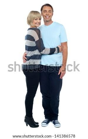 Pretty wife hugging her husband - stock photo