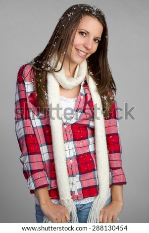 Pretty winter teen girl smiling - stock photo