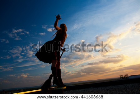 pretty witch with broom - stock photo
